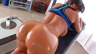 Curvy dark haired milf Lisa Ann with huge tits takes off her string thong and shows off her bare bubble butt. She displays her wet sexy bottom and then plays with her juggs on camera